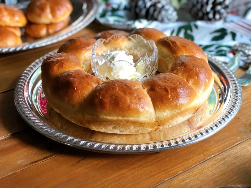 Rutabagas dinner rolls served on a tray with whipped butter
