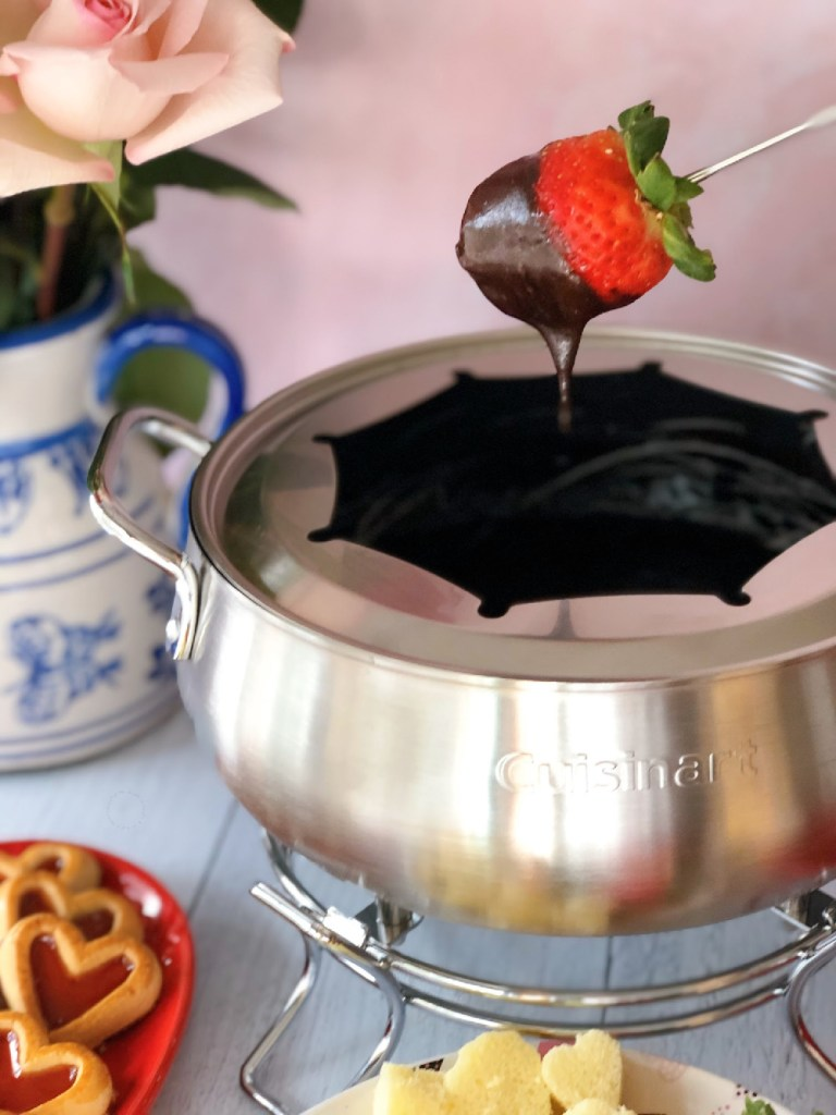 Dipping strawberries in warm chocolate fondue