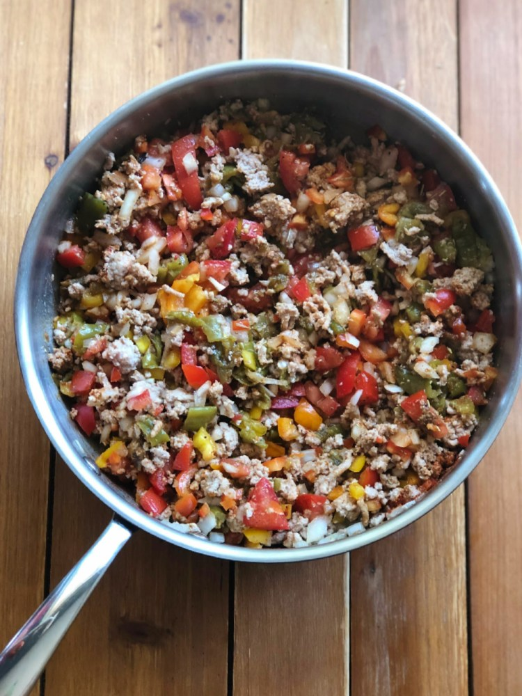 Cooking turkey picadillo in a skillet