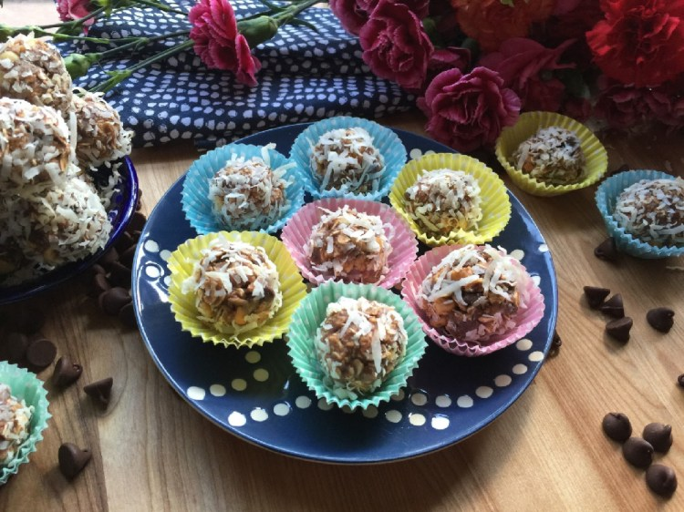 These are the Mexican Chocolate Peanut Truffles with Coconut have condensed milk, oats, chocolate powder, peanuts, coconut flakes, peanut butter, and chocolate morsels.