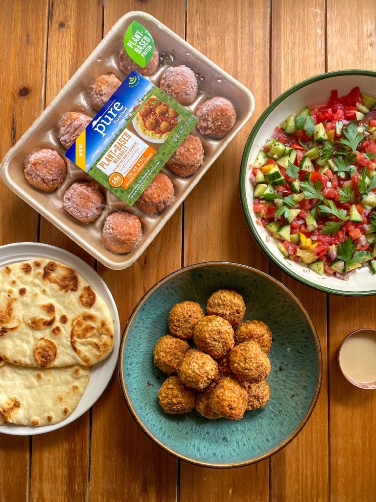 The components for the Turkish inspired meal include plant-based meatballs, flatbread, cucumber salad with preserved lemons, and a tahini sauce. All pictured here.
