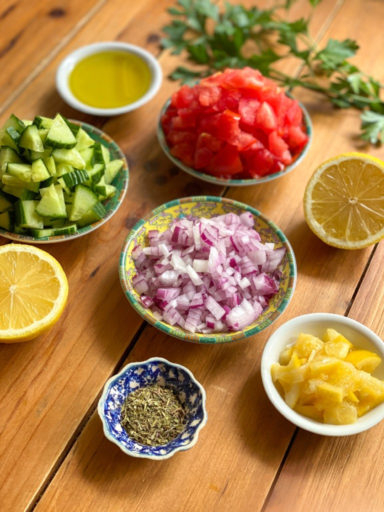 The ingredients for the cucumber salsa include preserved lemons, tomato, purple onion, lemon juice, olive oil, and Italian spices