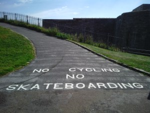 "Painted text on the ground saying ""No cycling, no skateboarding"""