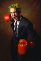 Man in a suit with boxing gloves