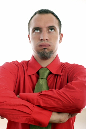 Man in red with green tie looking confused