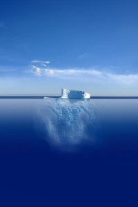 A picture of an iceberg, with most of the iceberg submerged below the water-line