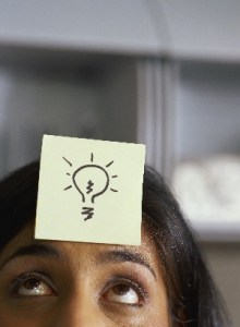 Lady with sticky note showing lighbulb