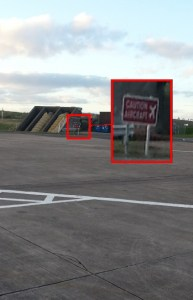 """Picture of runway with sign """"danger aircraft"""""""