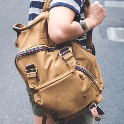Picture of a student wearing a rucksack on one shoulder