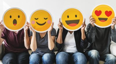 Social Media Emoji Masks Over People's Faces: Surprised, Smiling, Happy, Hearts