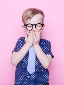 Boy in tie and glasses