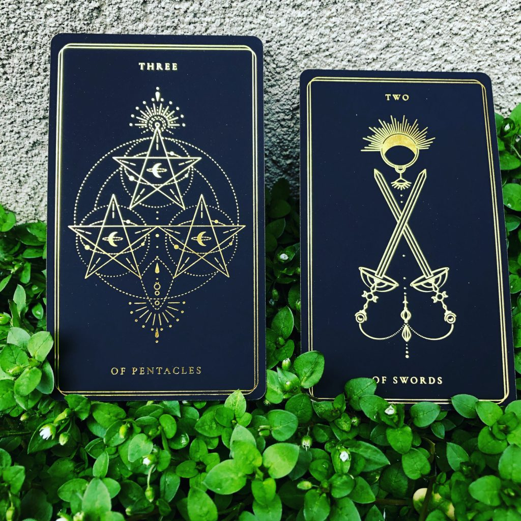 Pair Three: Three of Pentacles and Two of Swords
