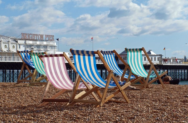 stripped deckchairs on brighton beach