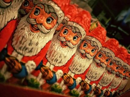 shelf of chocolate santa's lined up