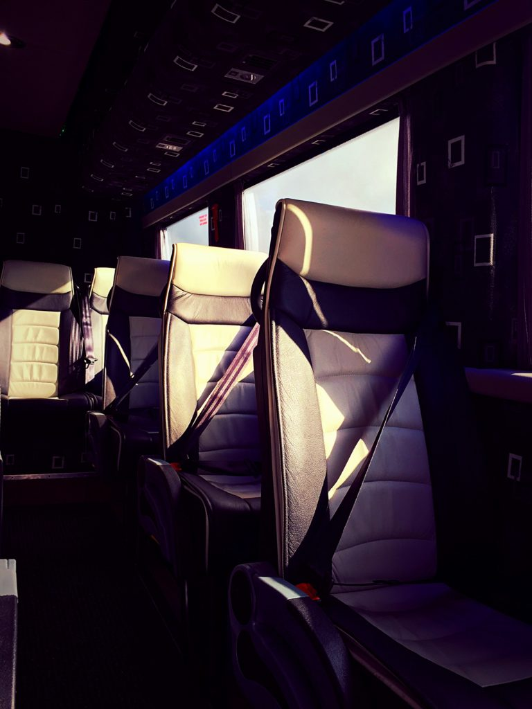 Close up of leather seats inside luxury 2009 Mercedes Sprinter Minibus Hire