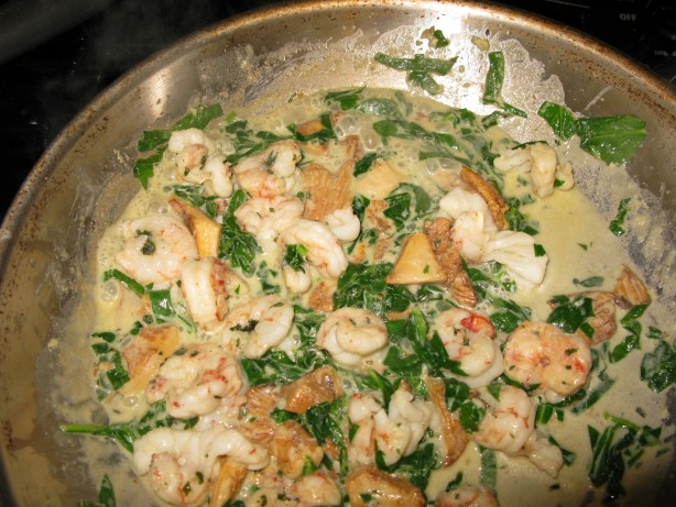 Shrimp, chanterelles, spinach, butter and cream over pasta
