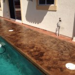 Stamped Pool Deck: - Sierra Solid Base - Seasoned Earth TiqueWash