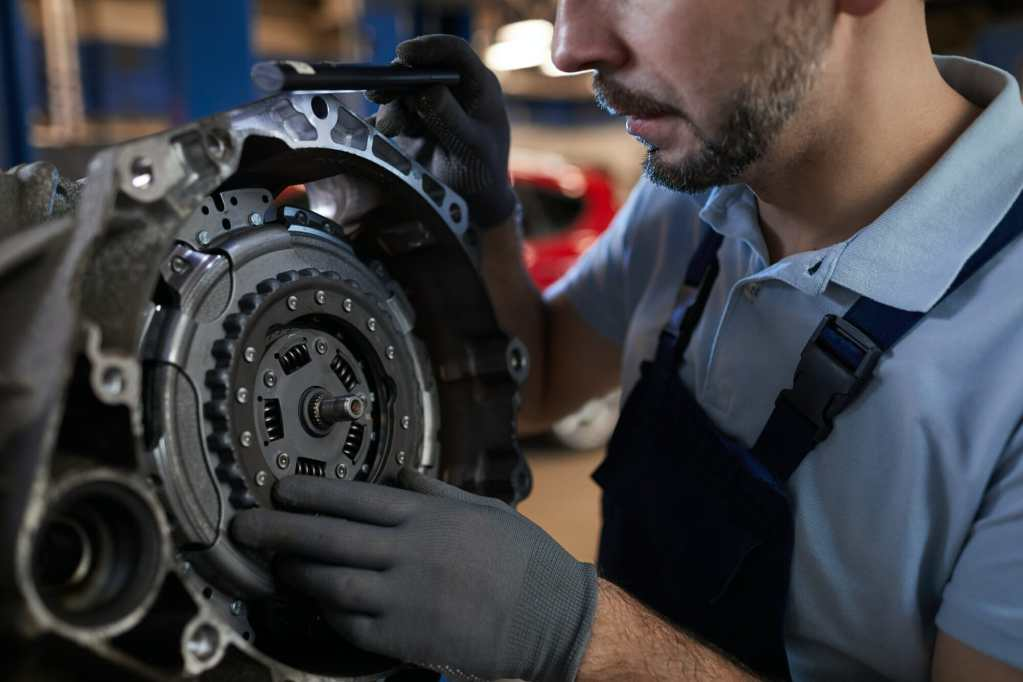 Auto Mechanic Fixing Car Part