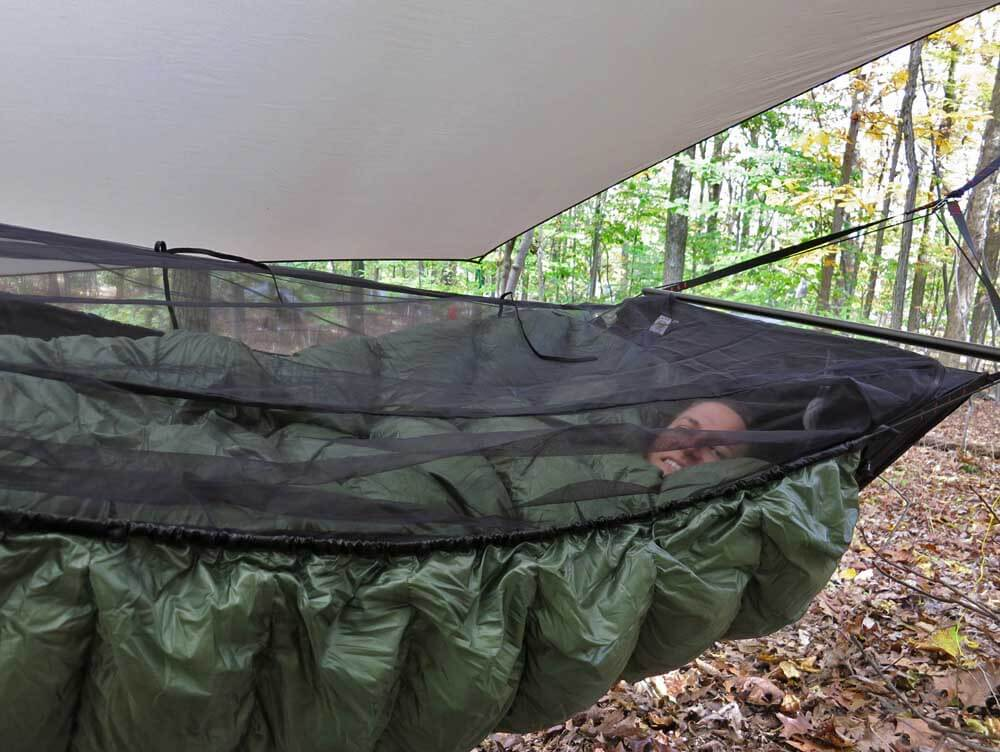 A good top and bottom quilt make all the difference for a warm night's sleep. Pictured above is my wife, Alison, cocooned in down -- a Jacks R Better High Sierra Sniveller top quilt and Greylock 3 under-quilt.