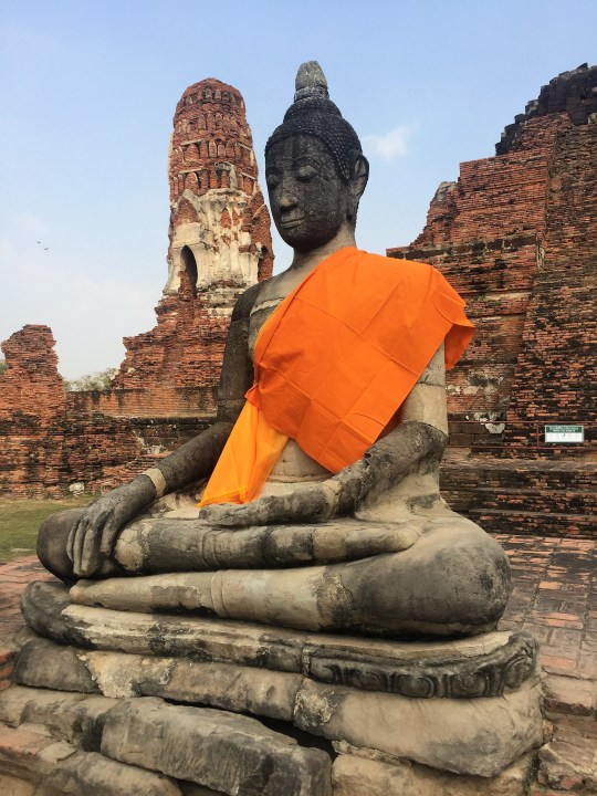 Buddha in front of temple - Ayutthaya, Thailand