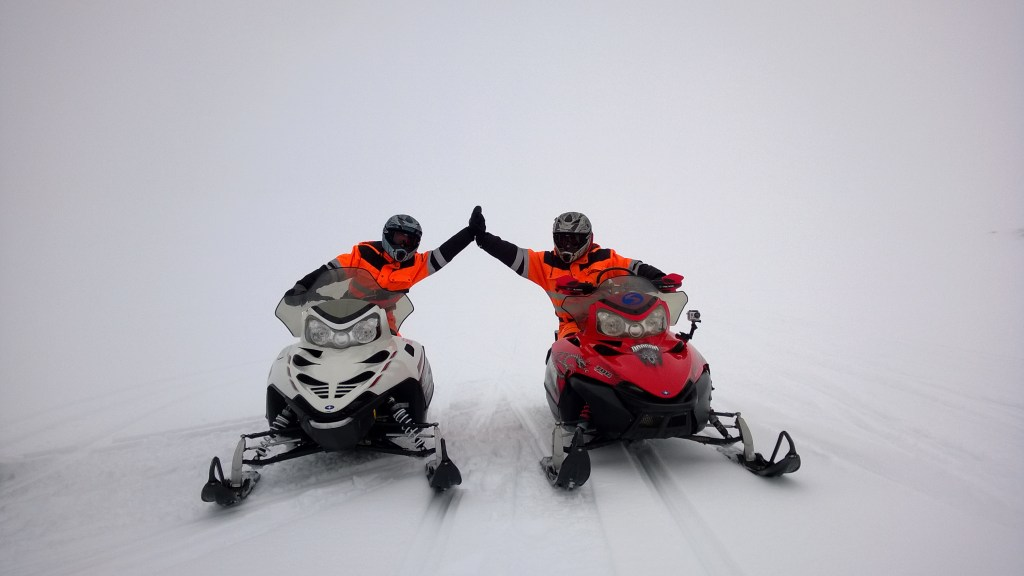 Snowmobiling in the thick fog on a glacier!