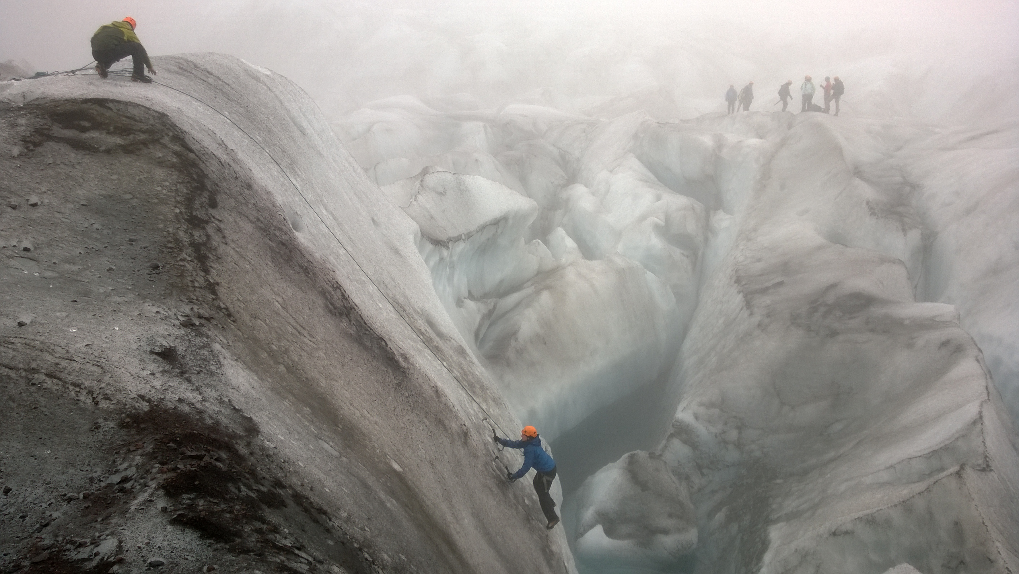 Climbing out of a crevasse.