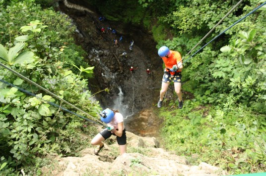 Rappelling down the 165 foot waterfall