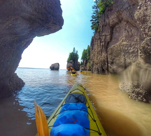 Kayaking around the rocks.