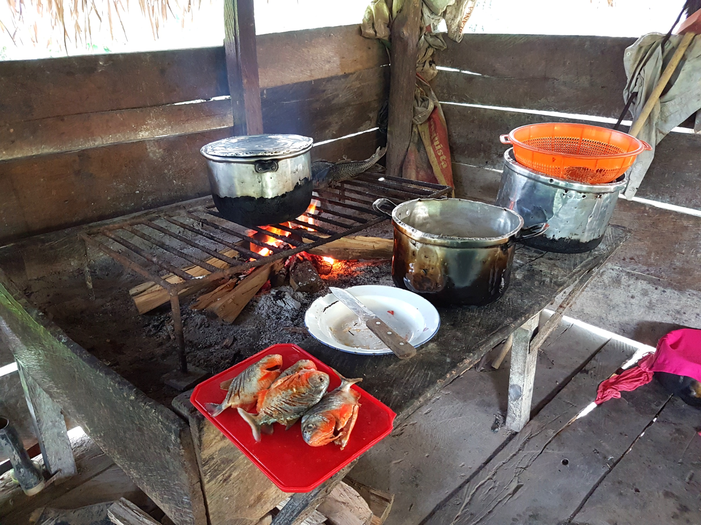 Our lunch cooking in one of the villagers kitchens.
