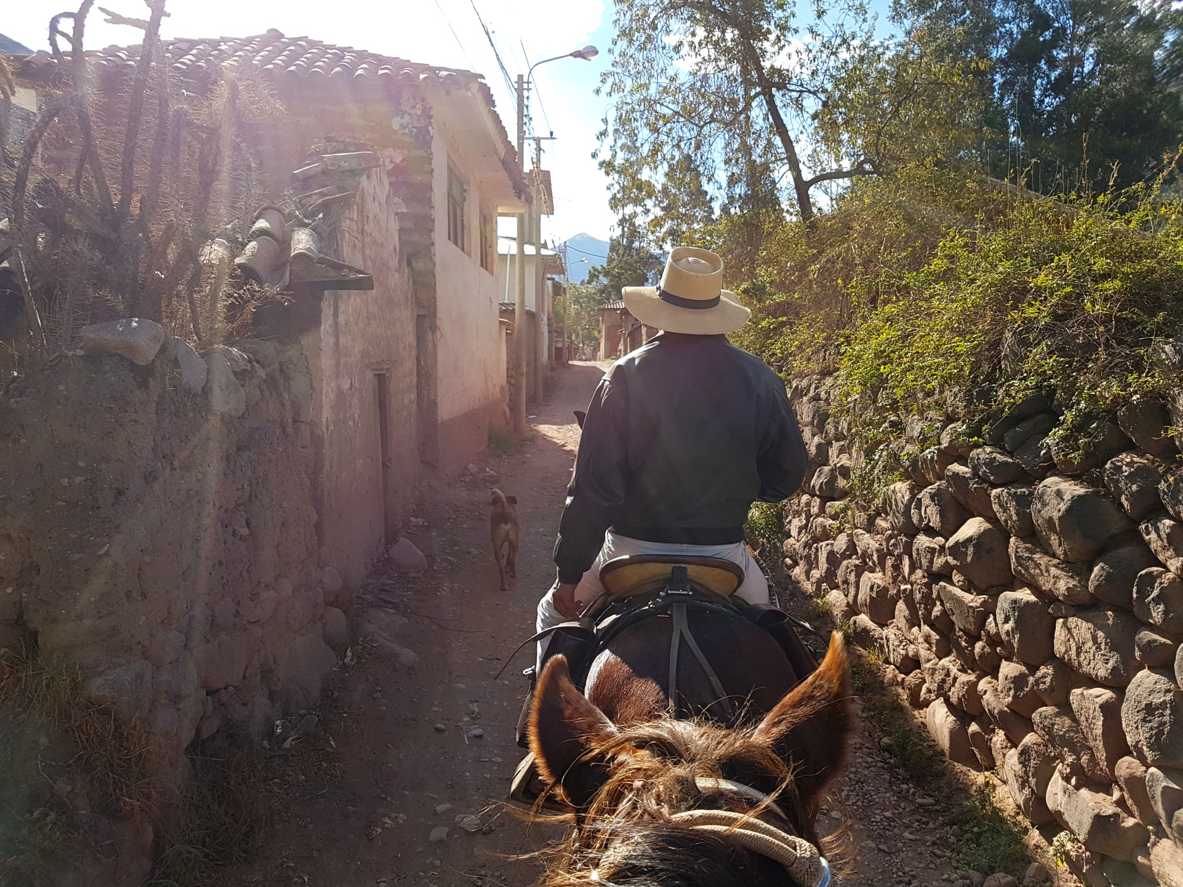 Riding through the back streets of Urubamba.