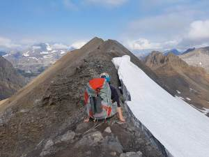 Sliding on our butts across the narrowest section of Northover Ridge.