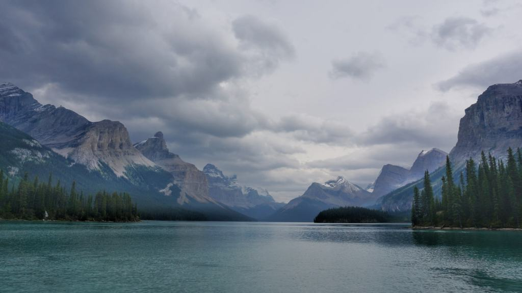 Stunning mountain views down Maligne Lake.