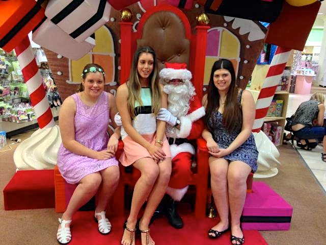 Every year Mum makes My sister and I get a photo with Santa! Event though we are 21, 18 and 13.