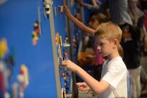boy playing legos on wall
