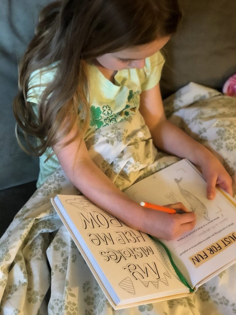 Girl drawing in Big Life Journal