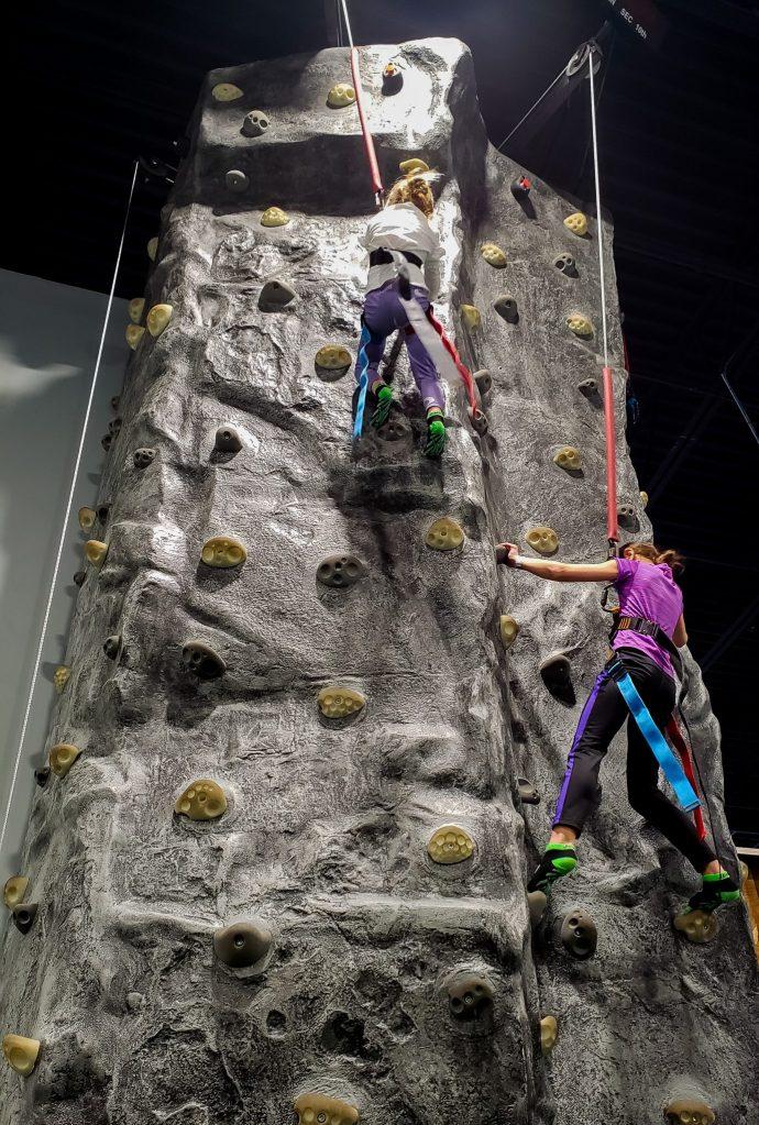girls rock climbing