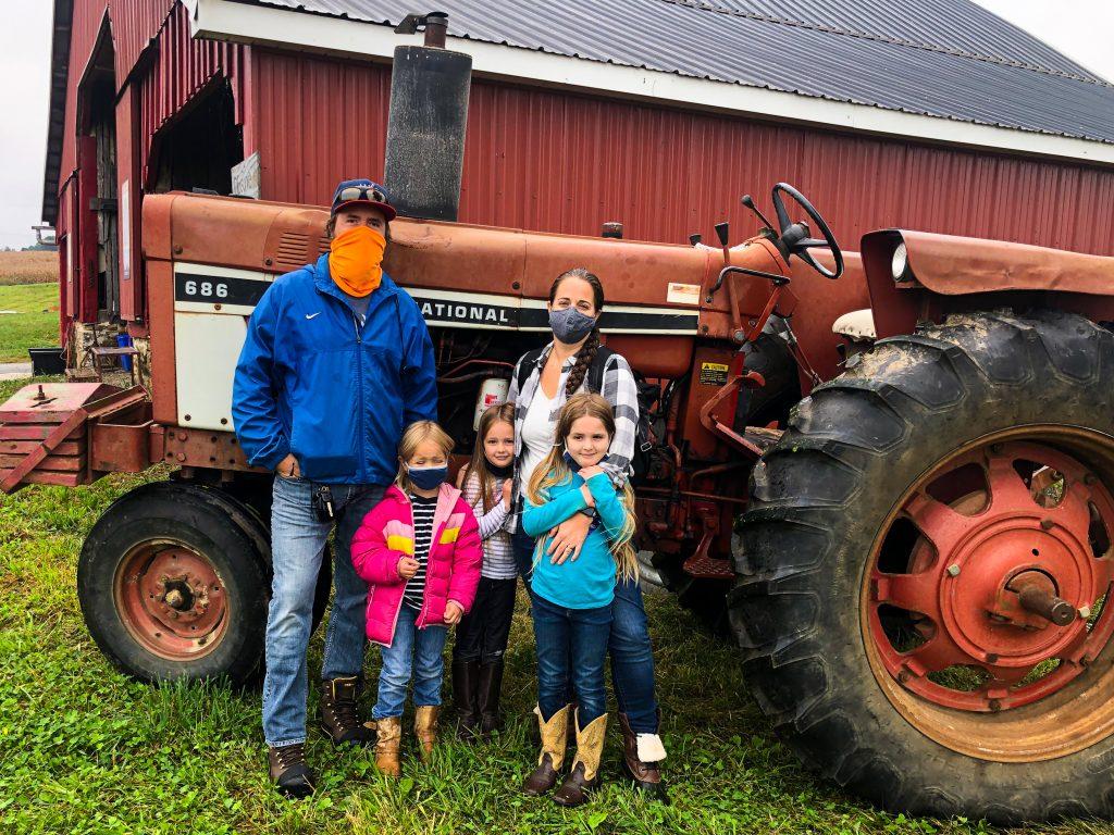 family farm festival with masks