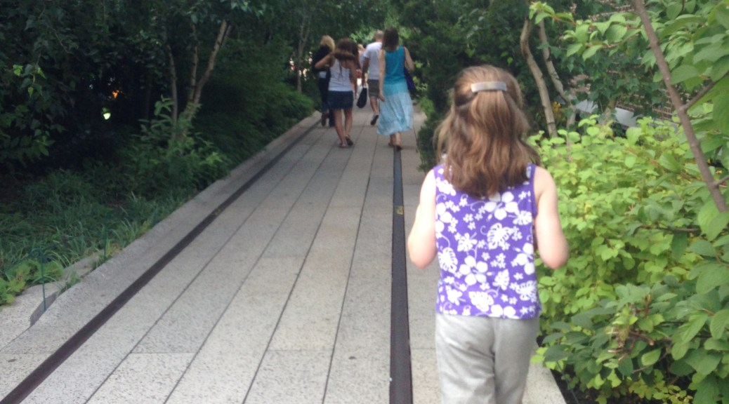 child walking on highline park in New york city