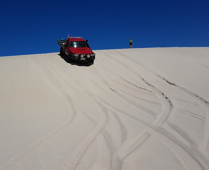 Aaron takes his Patrol down the dune.
