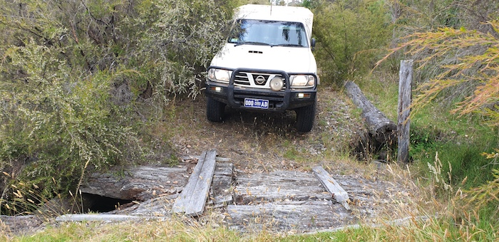 Mushy drives his Troopy over the wooden bridge.