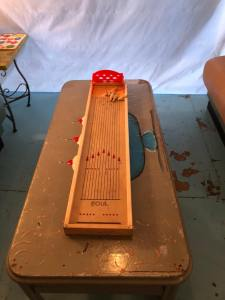 How cute is this old school table top bowling. I want one for my house. Back room at soda pops sugar shack Boerne Texas