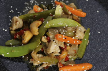 This spicy cashew chicken is easy, delicious, and ready in no time. Crispy vegetables, tender chicken and tossed in a sweet and spicy sauce.