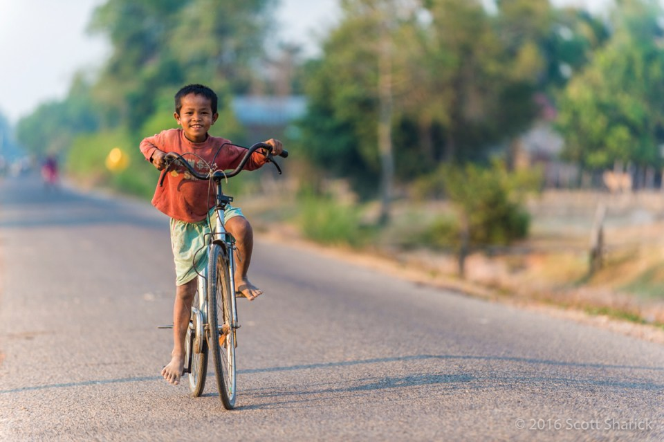 Cambodian boy rides his bicycle