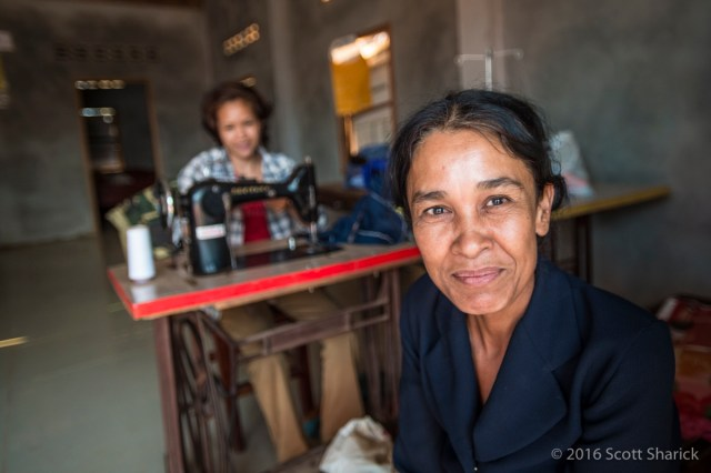 Two Cambodian woman in their business in their home.