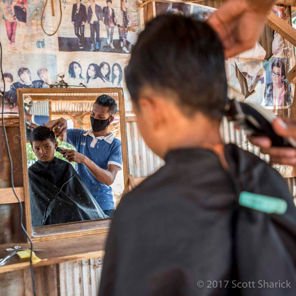 Haircut day for a dad and his three sons.
