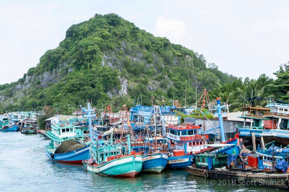 Fishing boats in front of a hill along the southern coast of Vietnam