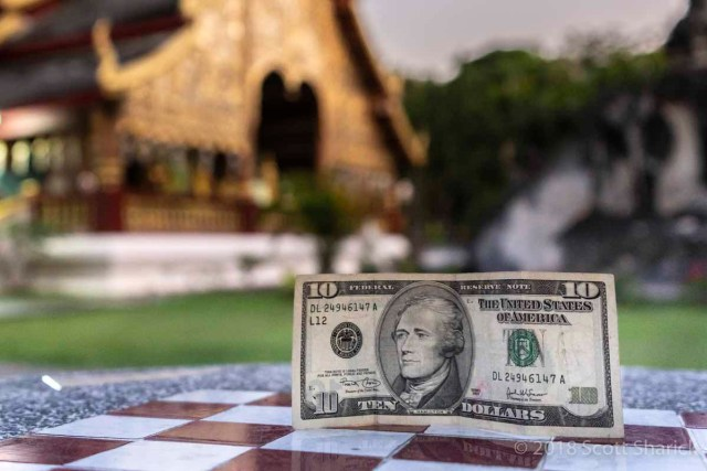 A ten dollar bill in front of a temple in Chiang Mai, Thailand