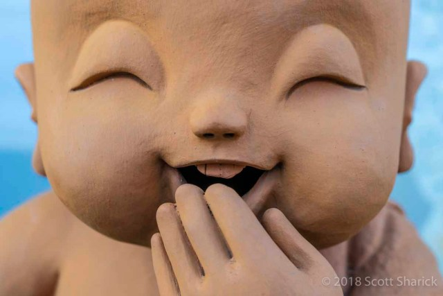 A smiling statue of a young Buddha in Chiang Mai, Thailand