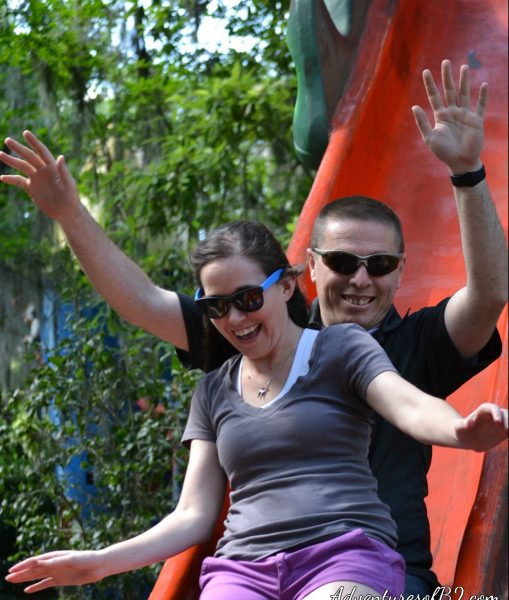Catch some air on the dragon slide in Storyland. Feel like a kid again with this engagement photo idea! Check out our other cute couple photo ideas over at adventuresofb2.com