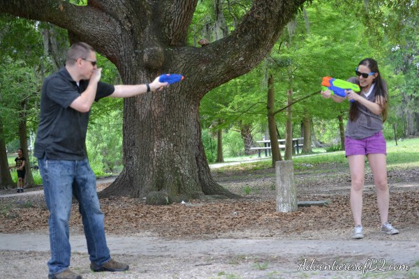 Make your engagement photos memorable with this fun water gun photoshoot idea! Perfect couple photo idea that makes for a great engagement photo idea! More over at adventuresofb2.com